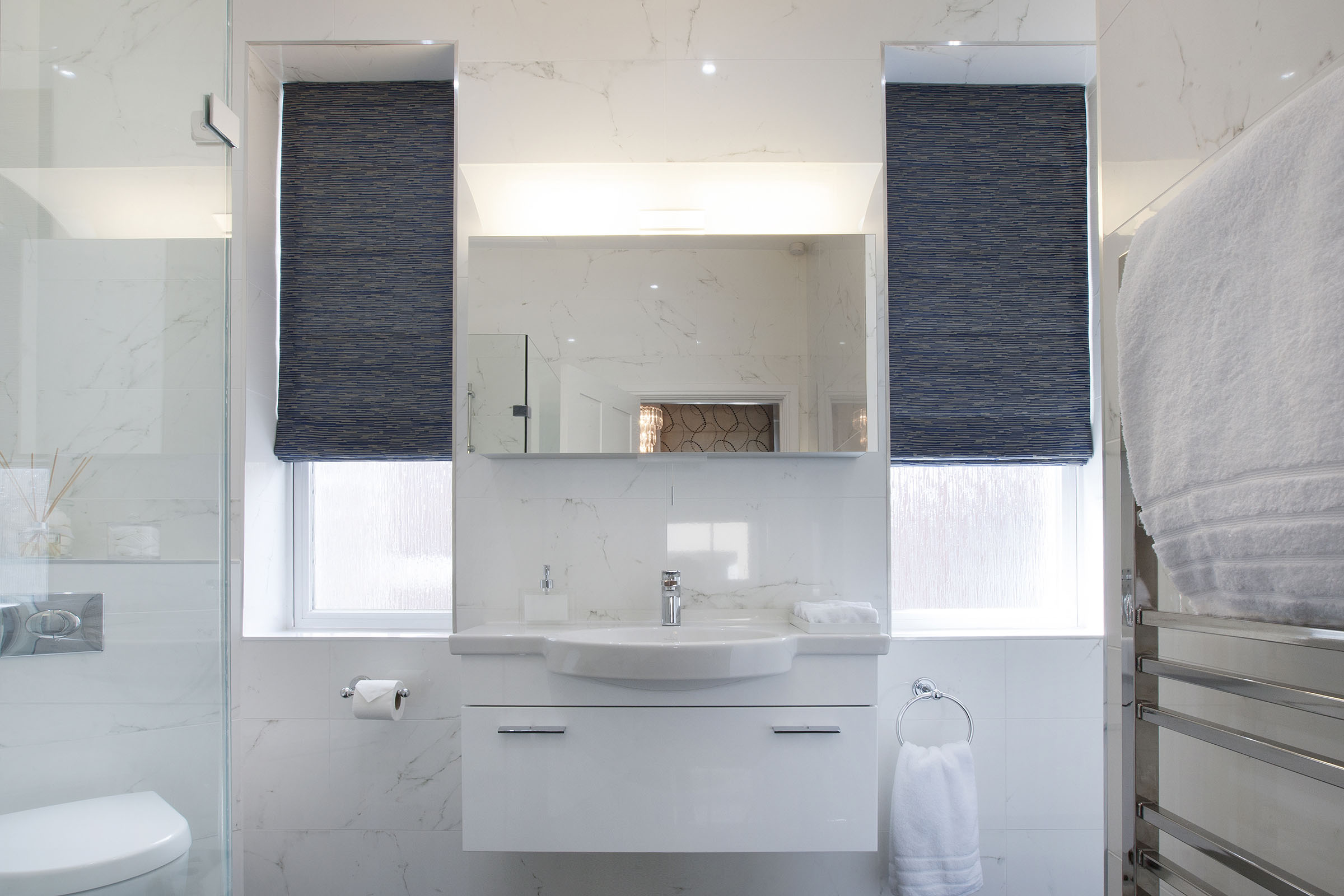 Bathroom with grey blinds