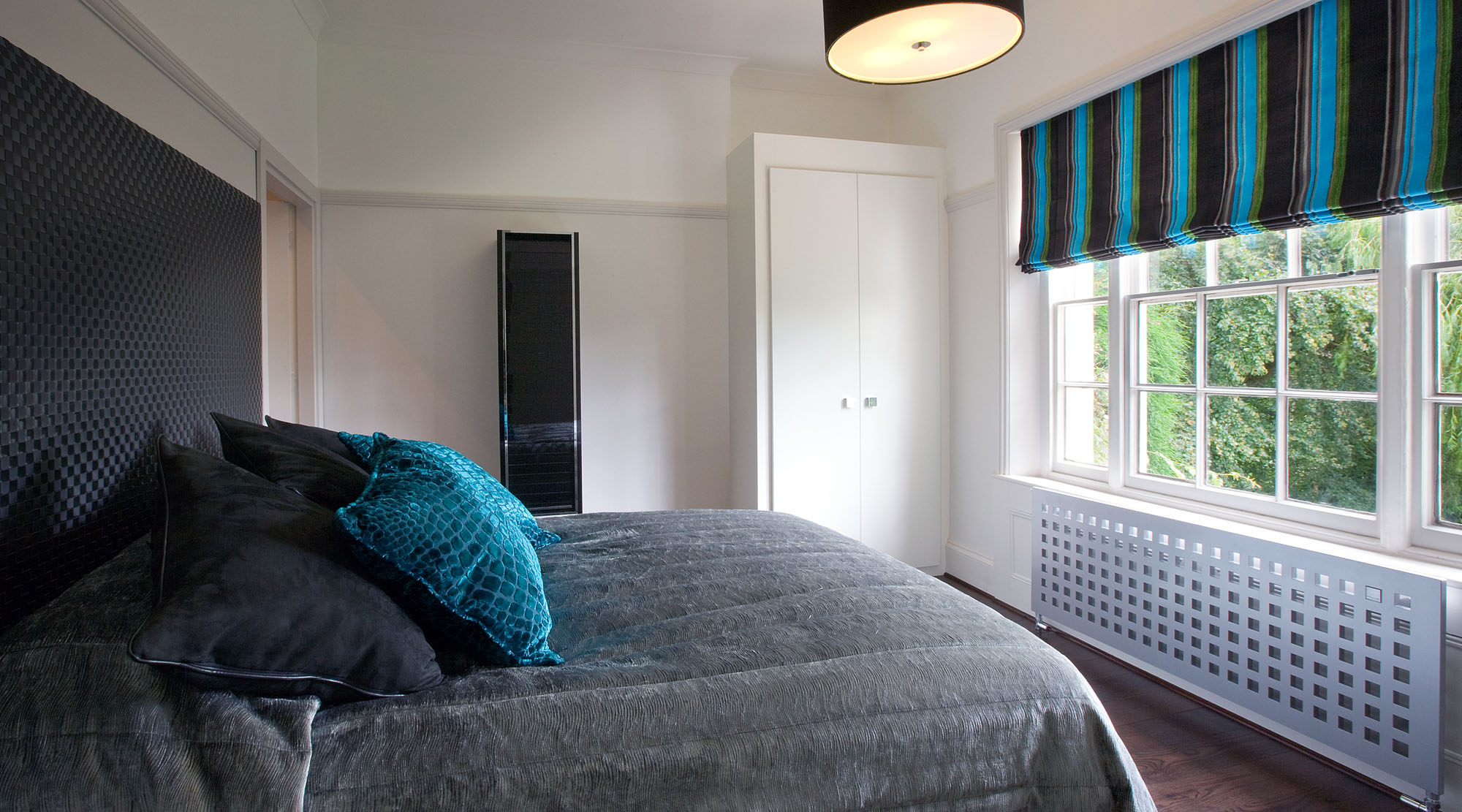 Turquoise, grey and black bedroom