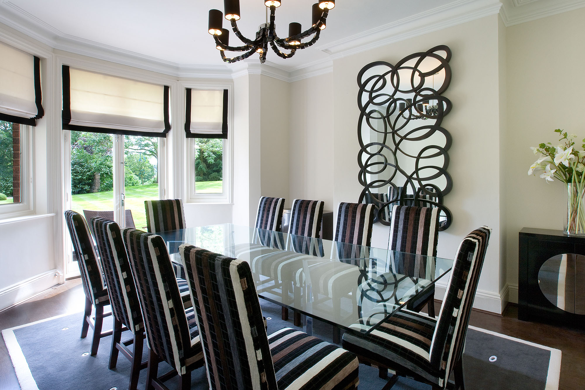 Contemporary striped dining room furniture based on a black and white theme.