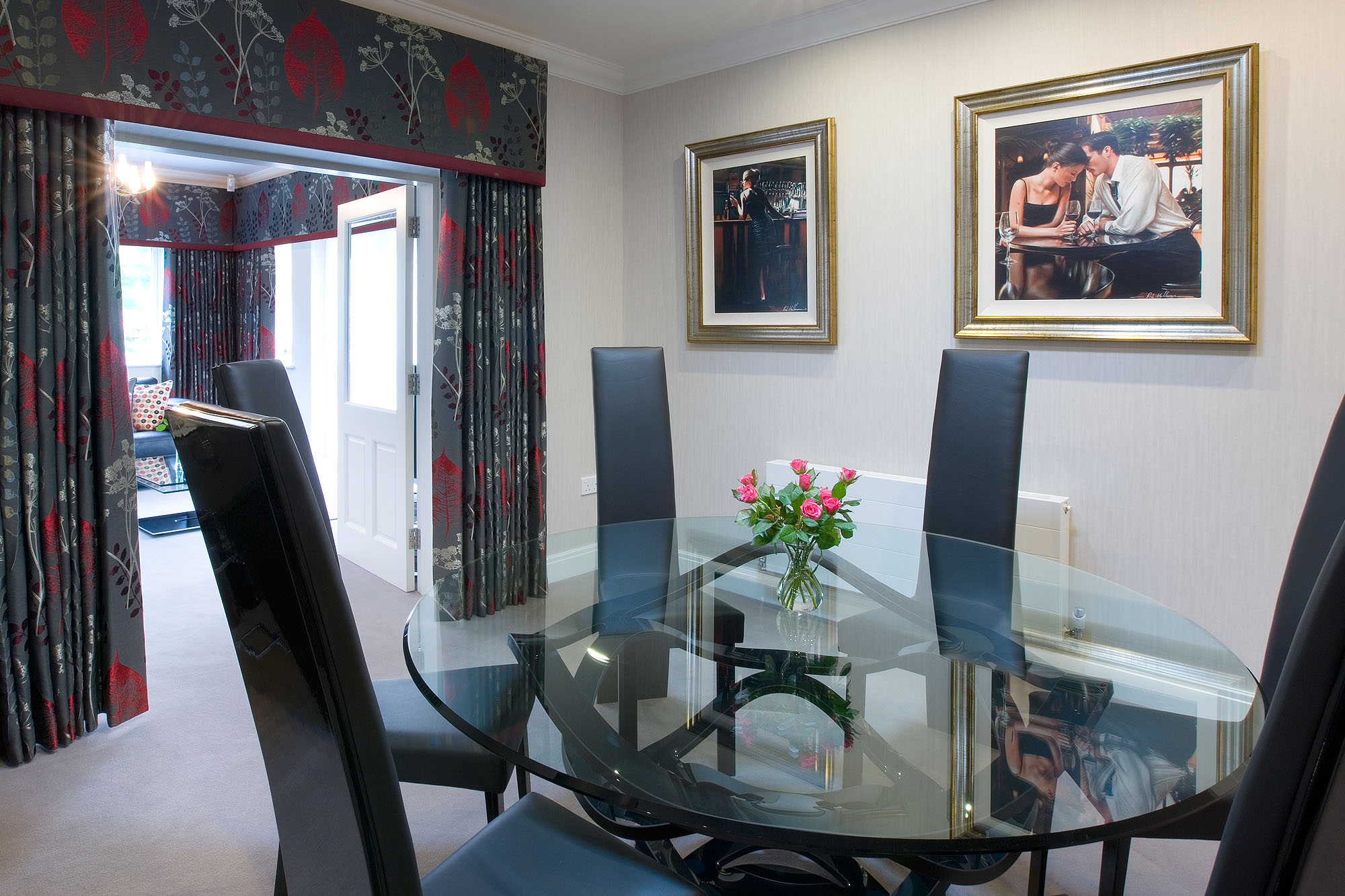 Contemporary black, grey and red dining room showing a padded pelmet and full length curtains.