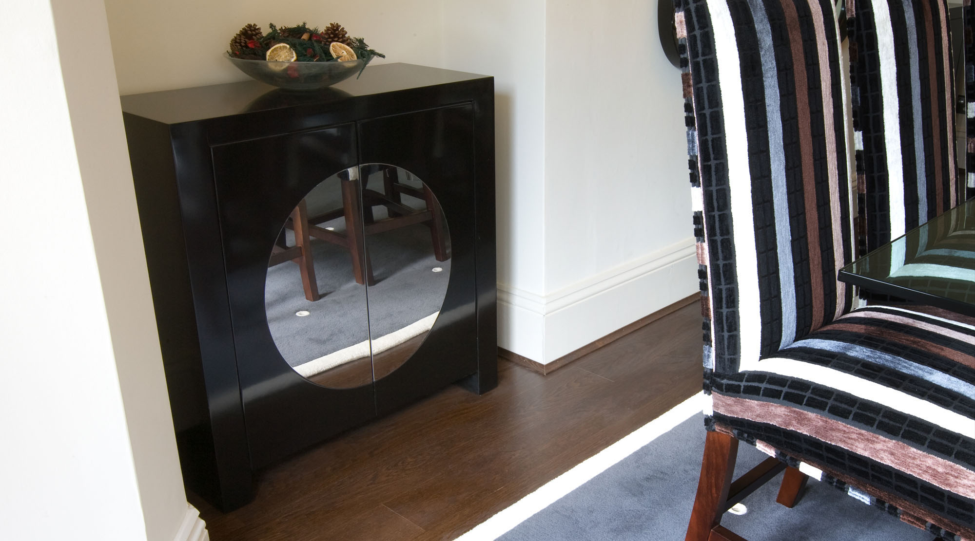 Dining room chair and black mirrored cupboard