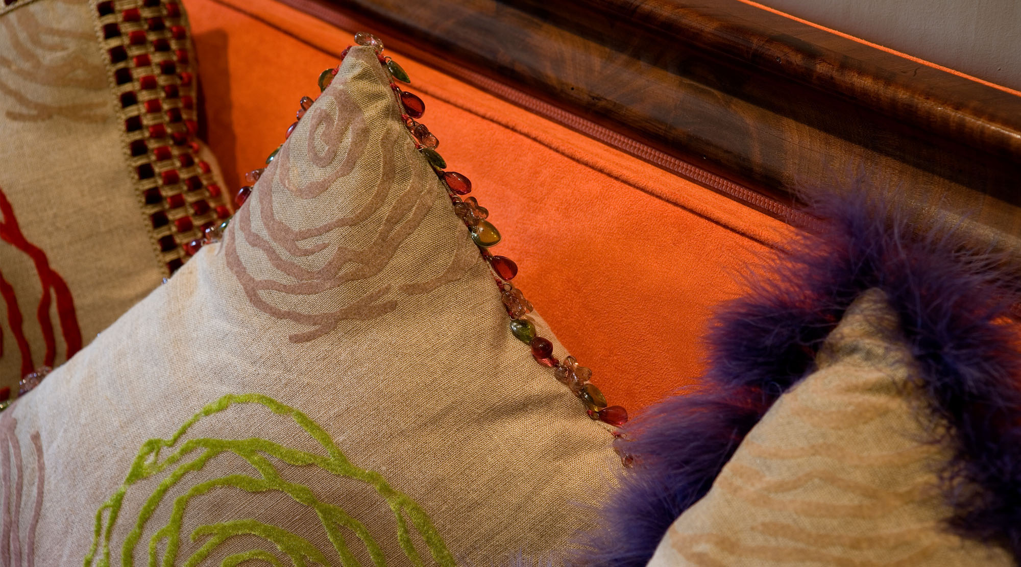 Luxury cushions on sofa trimmed with beads and faux fur.