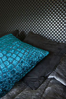 Meallic style fabric used on aqua cushions and black padded headboard.